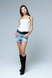 Girl wearing denim shorts Royalty Free Stock Photos