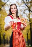 Girl wearing Dirndl with Pretzel and beer mug Stock Image