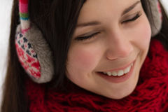 Girl wearing earplugs outdoors in winter Royalty Free Stock Photos
