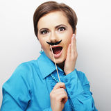 Girl wearing fake mustaches. Stock Photos