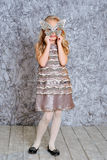 Girl wearing fashion dress and a mask Stock Photography