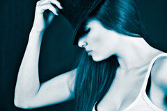 Girl wearing a fedora hat Stock Photo