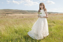 Girl wearing first communion dress Royalty Free Stock Images