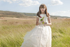 Girl wearing first communion dress Stock Photo