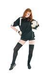 Girl wearing football outfit with ball Royalty Free Stock Photography