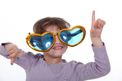 Girl wearing funky glasses Royalty Free Stock Images