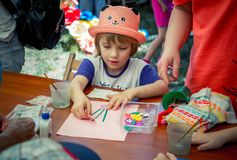 Free Girl, Wearing Funny Cat Shaped Hat, Participating At Art And Craft Outdoors Workshop Stock Photos - 132418323