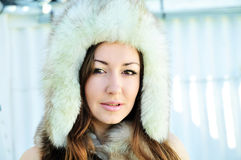 Girl wearing fur hat Royalty Free Stock Photography