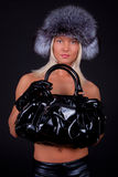 Girl wearing fur hat and holding a bag Stock Image