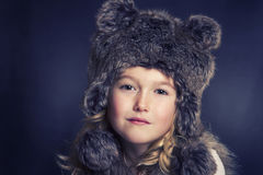 Girl wearing fur hat Royalty Free Stock Photos