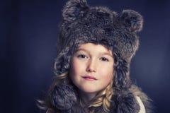 Girl wearing fur hat Royalty Free Stock Photos