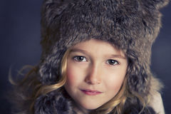Girl wearing fur hat Stock Image
