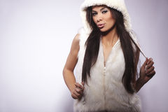 Girl wearing fur lined coat hood Stock Image