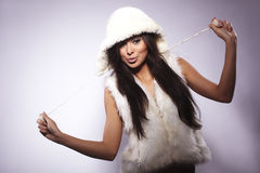 Girl wearing fur lined coat hood Royalty Free Stock Photos