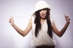 Girl wearing fur lined coat hood Royalty Free Stock Images