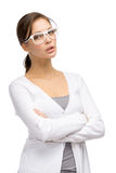 Girl wearing glasses with crossed hands Stock Images