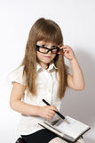 Girl wearing glasses with notebook Royalty Free Stock Image