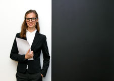 The girl wearing glasses with papers Royalty Free Stock Image
