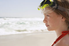 Girl Wearing Goggles Looking Away At Beach Royalty Free Stock Image