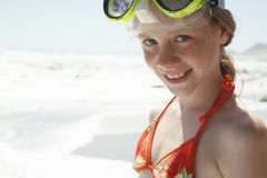 Girl Wearing Goggles Looking Away At Beach Royalty Free Stock Photography