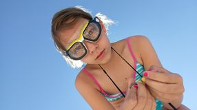Girl wearing goggles with pebbles stock image
