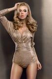 Girl wearing golden bodysuit Royalty Free Stock Photos