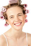 Girl wearing hair curlers Royalty Free Stock Images