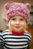 Girl wearing hat. Little girl preschool age wearing striped shirt and knit hat Royalty Free Stock Photos