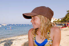 Girl wearing hat on beach Royalty Free Stock Photography