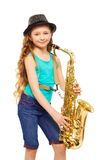 Girl wearing hat and playing alto saxophone Stock Photos