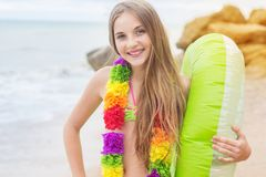 Girl is wearing hawaiian flowers with rubber ring Royalty Free Stock Photos