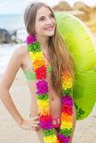 Girl is wearing hawaiian flowers with rubber ring Stock Photography