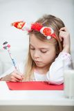 Girl Wearing Headband Writing Letter To Santa Royalty Free Stock Photo