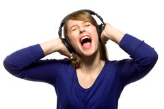 Girl wearing headphones royalty free stock images