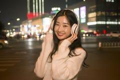 Beautiful girl to listen to music Stock Image