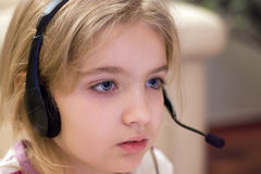 Girl wearing headset Stock Photos