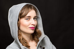 Girl Wearing Hood Smirking Royalty Free Stock Photography