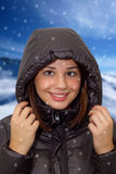 Girl wearing a hooded winter coat Royalty Free Stock Photos
