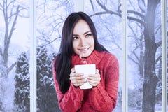 Girl wearing jumper enjoy hot drink Stock Photos