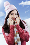 Girl wearing a jumper and smiling at camera Stock Photos