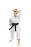 Girl wearing a kimono doing a karate kata Royalty Free Stock Photos