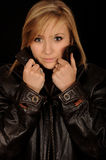 Girl wearing leather jacket Stock Images