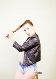 Girl wearing leather jacket and denim shirts Royalty Free Stock Photos