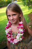 Girl wearing lei. Pretty girl wears a hawaiian lei that she made herself Stock Photos