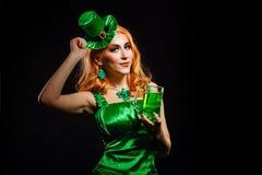 Girl wearing leprechaun Stock Images
