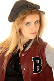 Girl wearing letterman jacket and hat with an attitude Royalty Free Stock Image