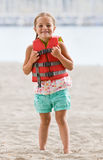Girl wearing life jacket at beach Royalty Free Stock Photos