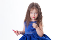 Girl is wearing lipstick Royalty Free Stock Photo