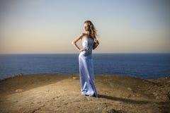 Girl wearing a long dress at the beach Stock Photos