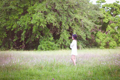 Girl Wearing Long Sleeve Shirt Standing on Green Grass Royalty Free Stock Photo